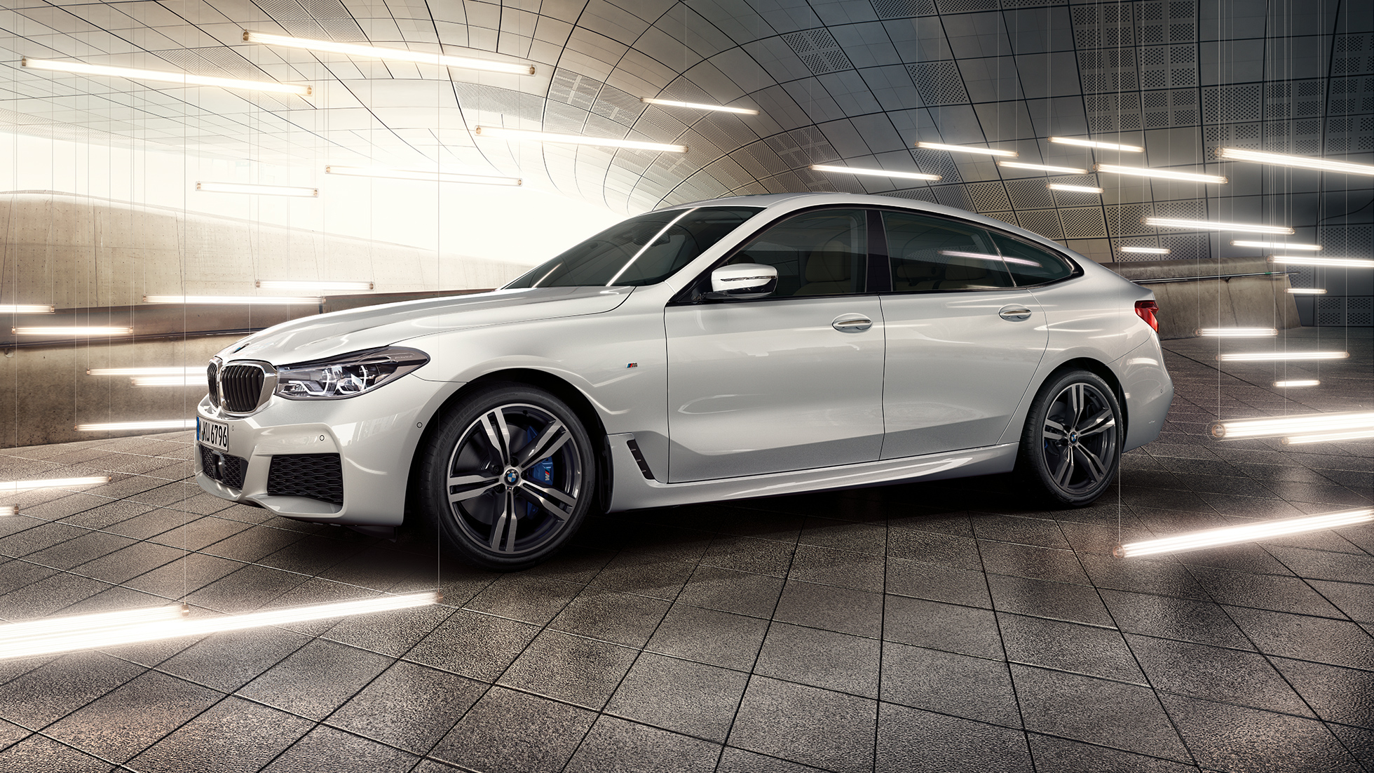 BMW 6 Series Gran Turismo G32 2017 Mineral White metallic side view with front
