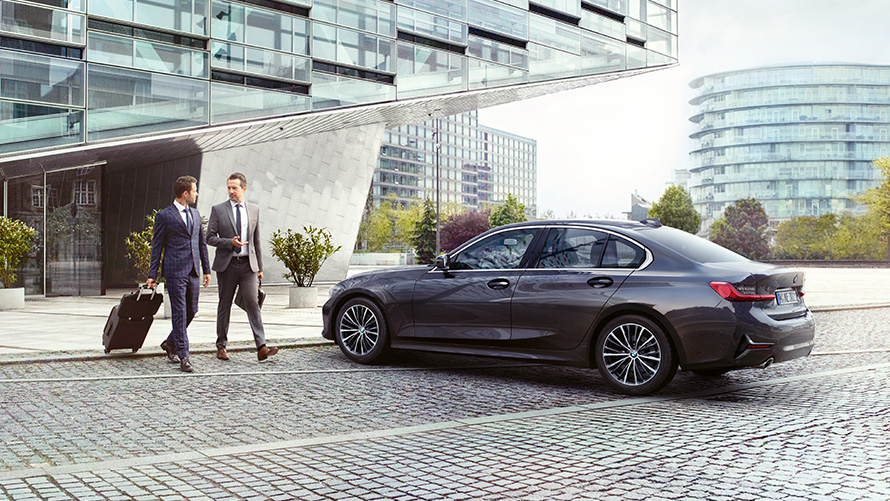 BMW Corporate sales services BMW financing and leasing for business clients Men going to BMW vehicle